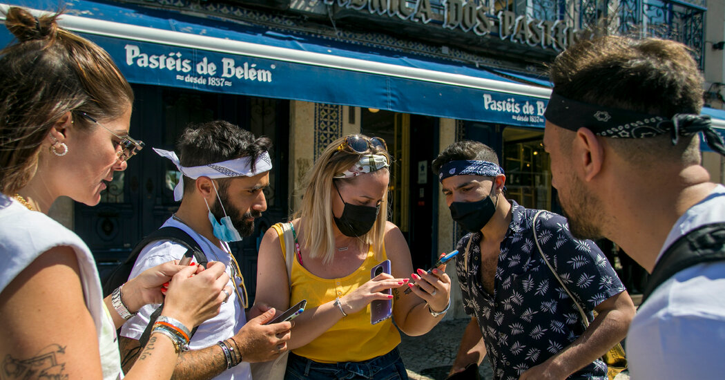 British Tourists Return to Portugal, Unleashed but (Mostly) Masked