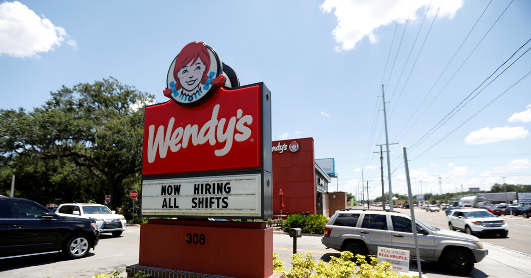 Wage gains remained strong in August as hiring slowed.